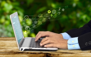 A businessman doing his job with  an internet connected laptop with a green background. Can be use for work from home concept